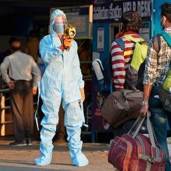 Un personal médico verifica la temperatura de los pasajeros antes de abordar un servicio especial de trenes de Secunderabad a Nueva Delhi, en las afueras de la estación de trenes de Secunderabad, la ciudad gemela de Hyderabad, el 13 de mayo de 2020. - La enorme red ferroviaria de India volvió a la vida tentativamente. El 12 de mayo, como un levantamiento gradual del bloqueo de coronavirus más grande del mundo, se aceleró incluso cuando surgieron nuevos casos. (Foto por NOAH SEELAM / AFP) | Foto:AFP
