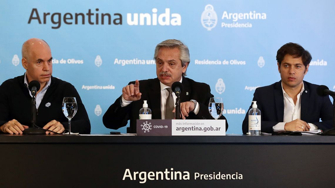 President Alberto Fernández, flanked by City Mayor Horacio Rodríguez Larreta, and Buenos Aires Province Governor Axel Kicillof, offers a press conference to announce new measures regarding the lockdown to slow the spread of the novel coronavirus Covid-19, at the Olivos Presidential Residence.