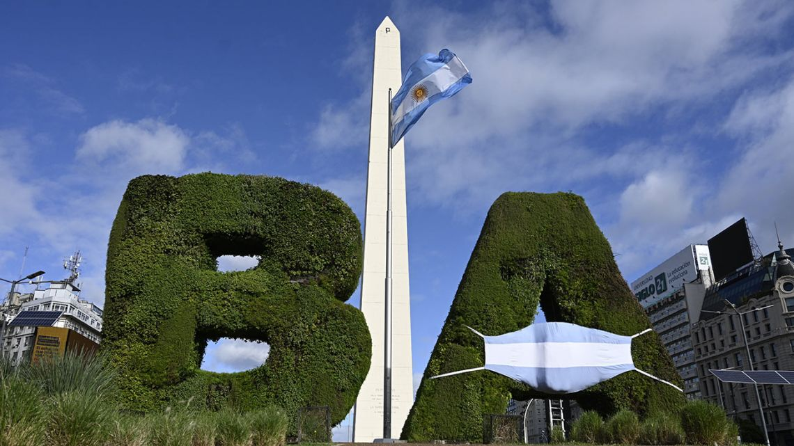 View of the BA sign wearing a mask in the colours of the Argentine flag during the 210th anniversary of the May Revolution amid a lockdown imposed by the government against the spread of the new coronavirus, by the Obelisk in Buenos Aires, on May 25, 2020.