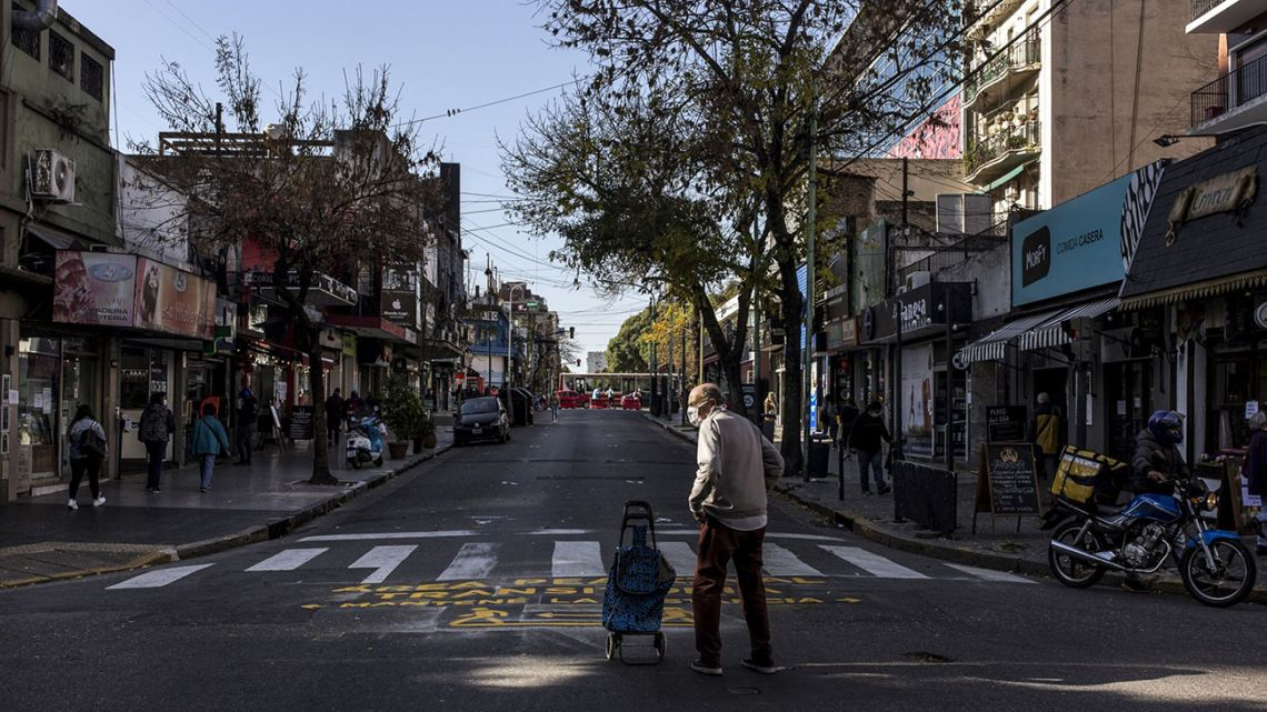 A man crosses a street in Buenos Aires during the coronavirus lockdown.