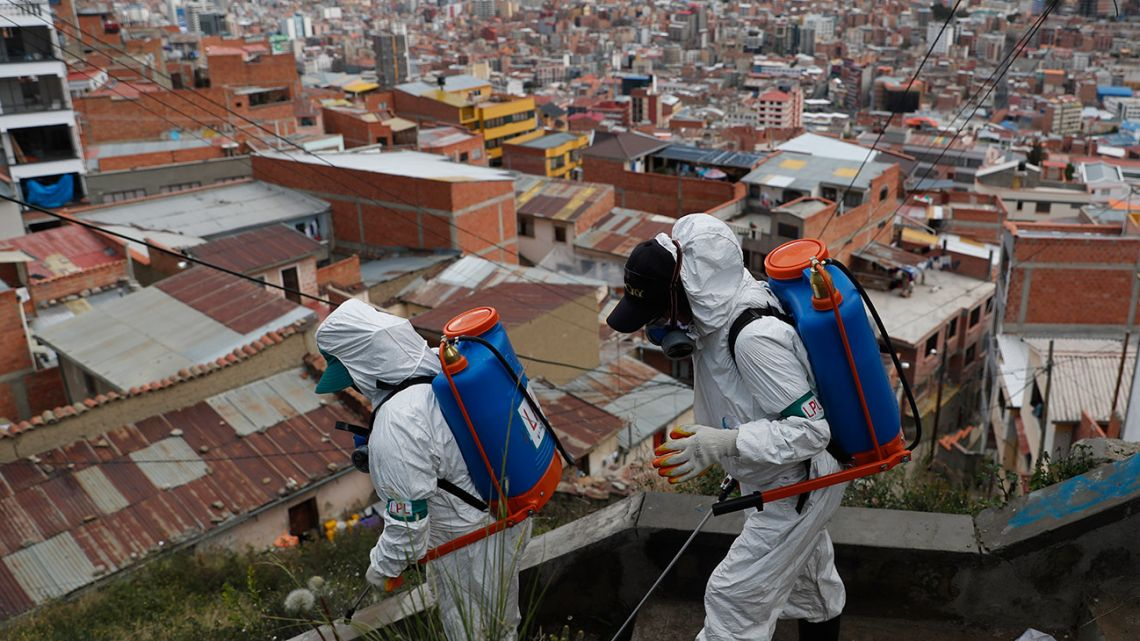 Workers disinfect a stairway in attempt to help contain the spread of the new coronavirus, in La Paz, Bolivia. Even amid a global pandemic, there's no sign that corruption is slowing down in Latin America. Perhaps the biggest case is in Bolivia, where the health minister was arrested amid allegations that officials bought 170 ventilators at inflated prices.