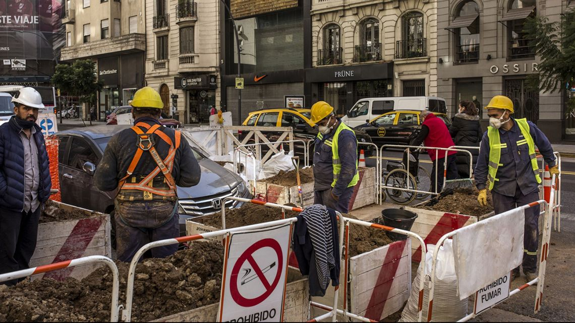 Renovation works are carried out on a street in Buenos Aires City, during the coronavirus pandemic.