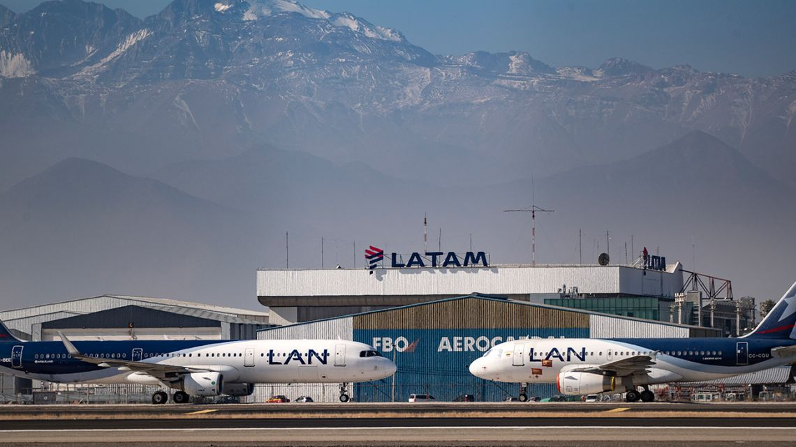 Latam airlines planes sit on the tarmac at Santiago International Airport, in Santiago on May 26,2020.