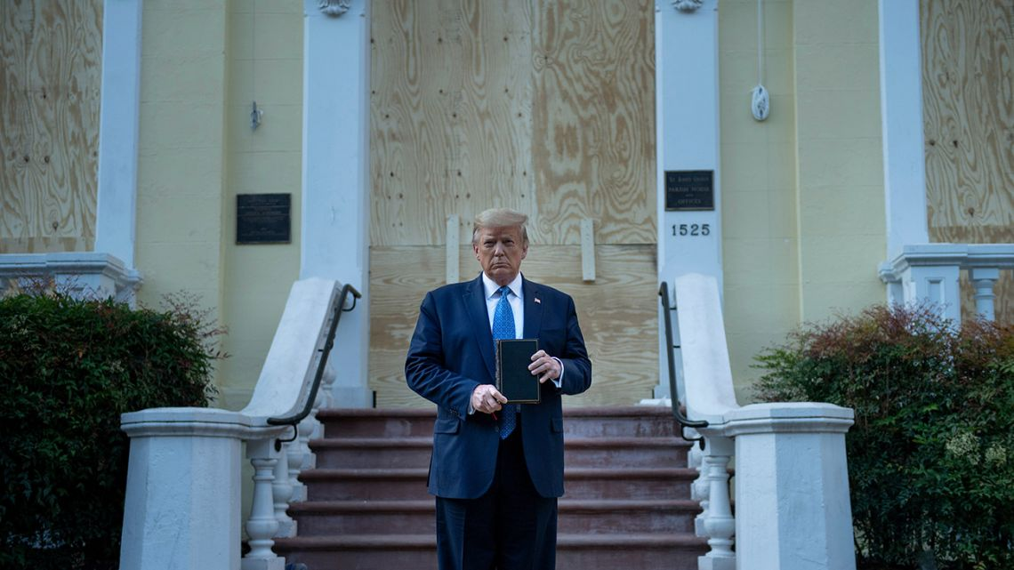 US President Donald Trump holds a Bible while visiting St. John's Church across from the White House after the area was cleared of people protesting the death of George Floyd, on June 1, 2020, in Washington, DC.