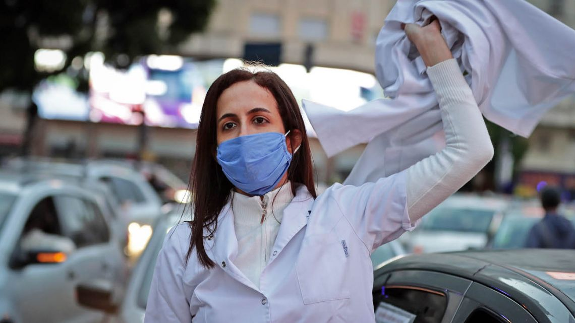 A doctor takes part in a protest in Buenoes Aires this week.