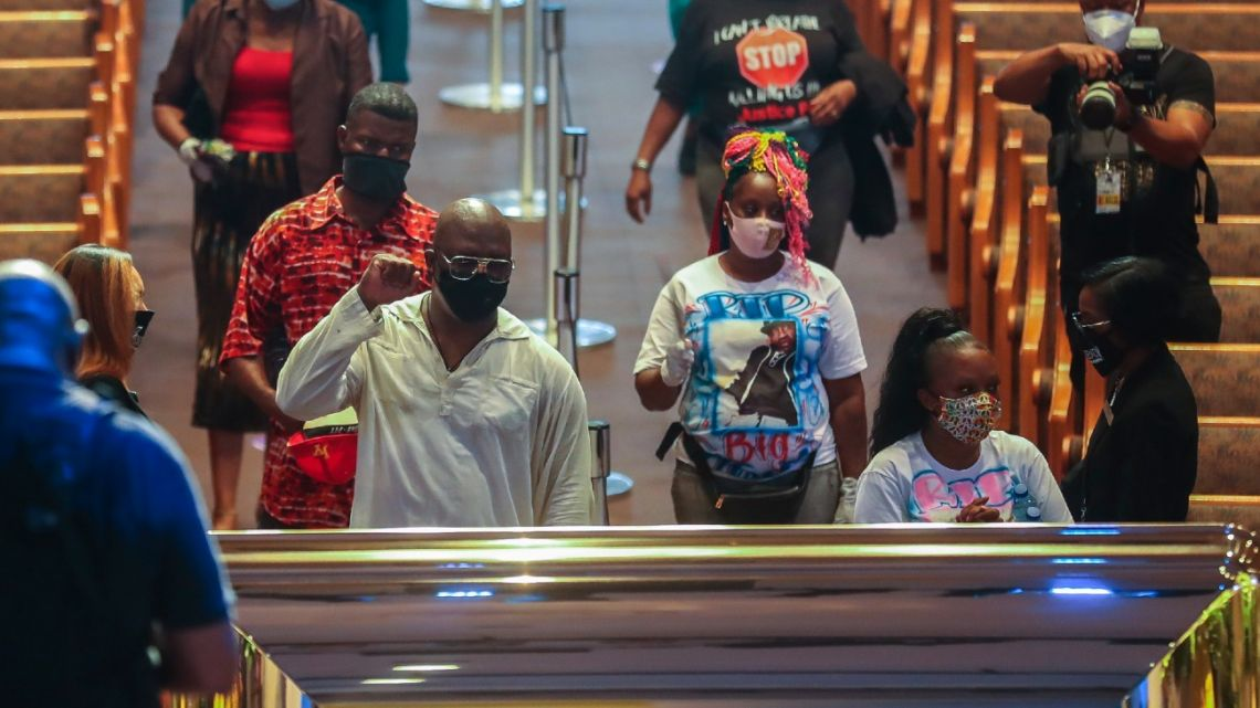 Mourners are guided into the Fountain of Praise Church during a public visitation for George Floyd Monday, June 8, 2020, in Houston. Floyd died after being restrained by Minneapolis Police officers on May 25.