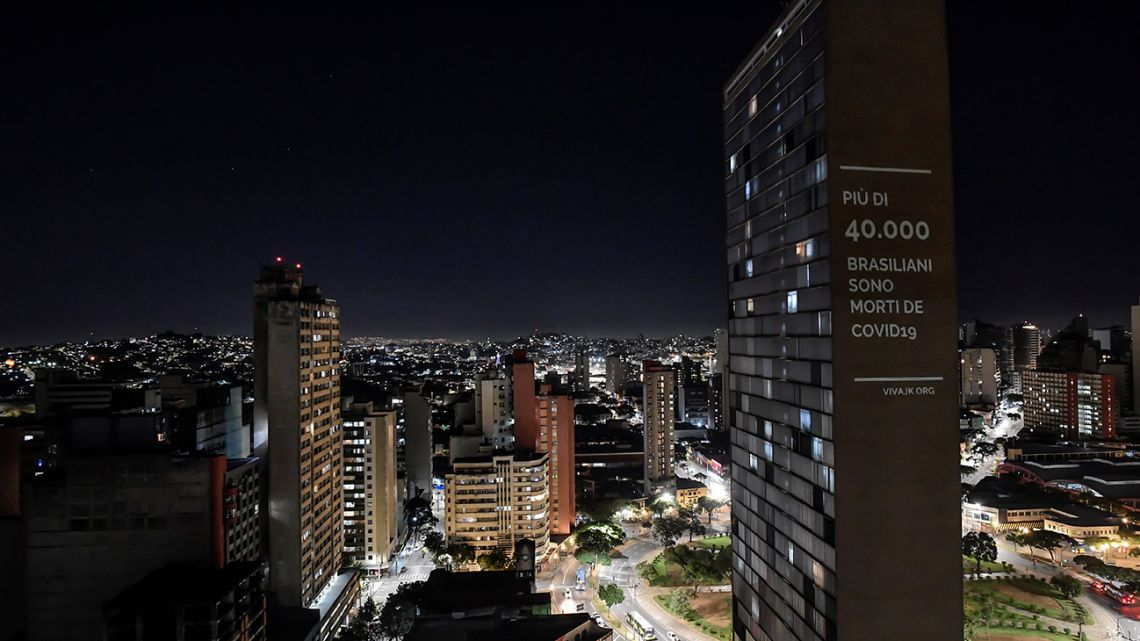 "View of a projection reading ""Over 40,000 Brazilians have died from COVID-19"", by VivaJK movement, in one of the towers of the JK building, in Belo Horizonte, state of Minas Gerais, Brazil, on June 11, 2020."