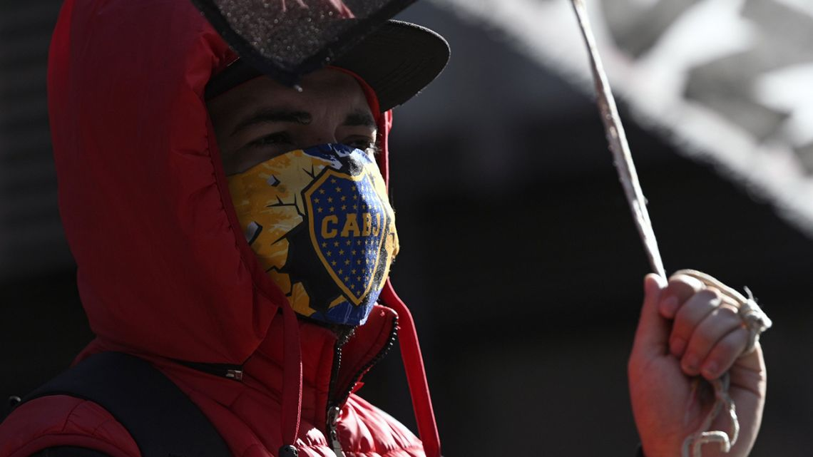 A man wearing a facemask with the shield of Boca Juniors' football team, pictured in the capital.