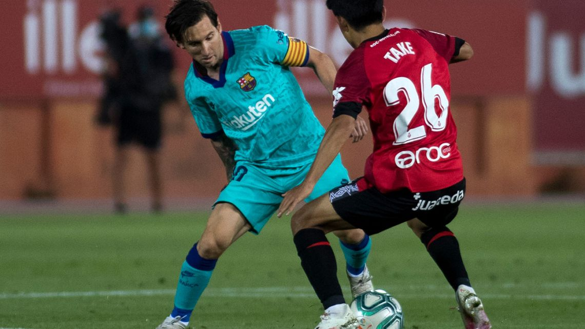 Real Mallorca's Japanese midfielder Takefusa Kubo challenges Barcelona's Argentine forward Lionel Messi during the Spanish League football match between RCD Mallorca and FC Barcelona at the Visit Mallorca stadium (Son Moix stadium) in Palma de Mallorca on June 13, 2020.
