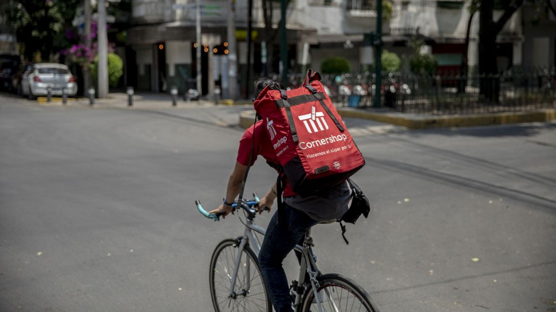 A worker makes a Cornershop delivery in Mexico City on April 3.