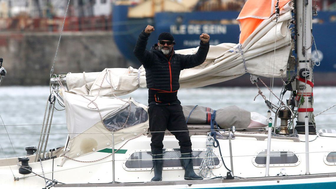 Juan Manuel Ballestero stands on his boat in Mar del Plata on Thursday, June 18, 2020. Ballestero crossed the Atlantic on a small sailboat, setting off from the port of Porto Santo in Portugal on March 24 and finally reaching Mar del Plata on Wednesday to be reunited with his parents after flights to Argentina were cut due to the COVID-19 lockdown.