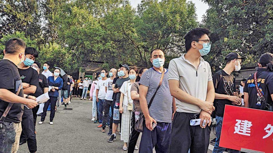 20200620_china_contagio_fila_coronavirus_brote_afp_g