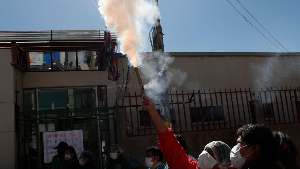 Health workers launch fireworks during a protest demanding that more doctors be hired and for better working conditions amid the new coronavirus pandemic, outside the Del Norte Hospital in El Alto, Bolivia, Tuesday, June 16, 2020.