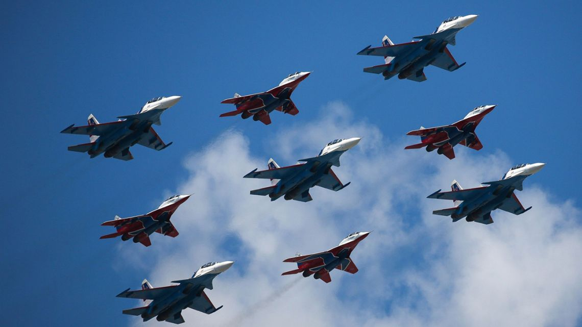 The Russian Knights and Strizhi aerobatic units fly Sukhoi Su-30SM and Mikoyan MiG-29 fighter jets during the victory day parade in Moscow, Russia, on Wednesday, June 24, 2020.