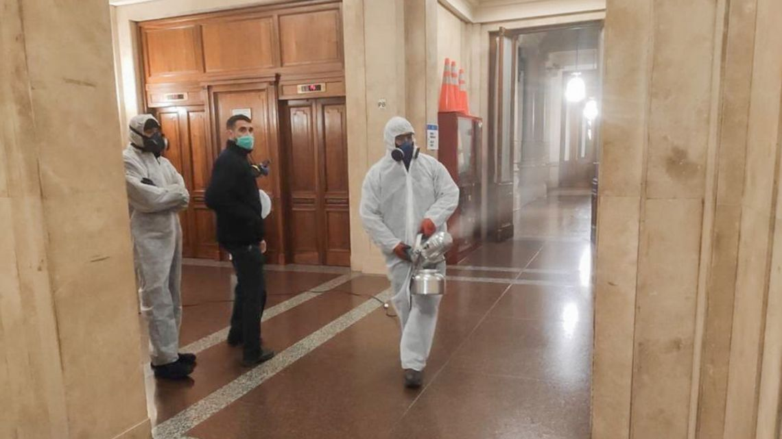 Buildings inside the Senate are disinfected by workers.