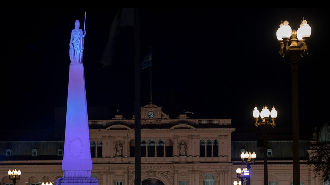View of the illuminated Piramide de Mayo in Buenos Aires on June 28, 2020.