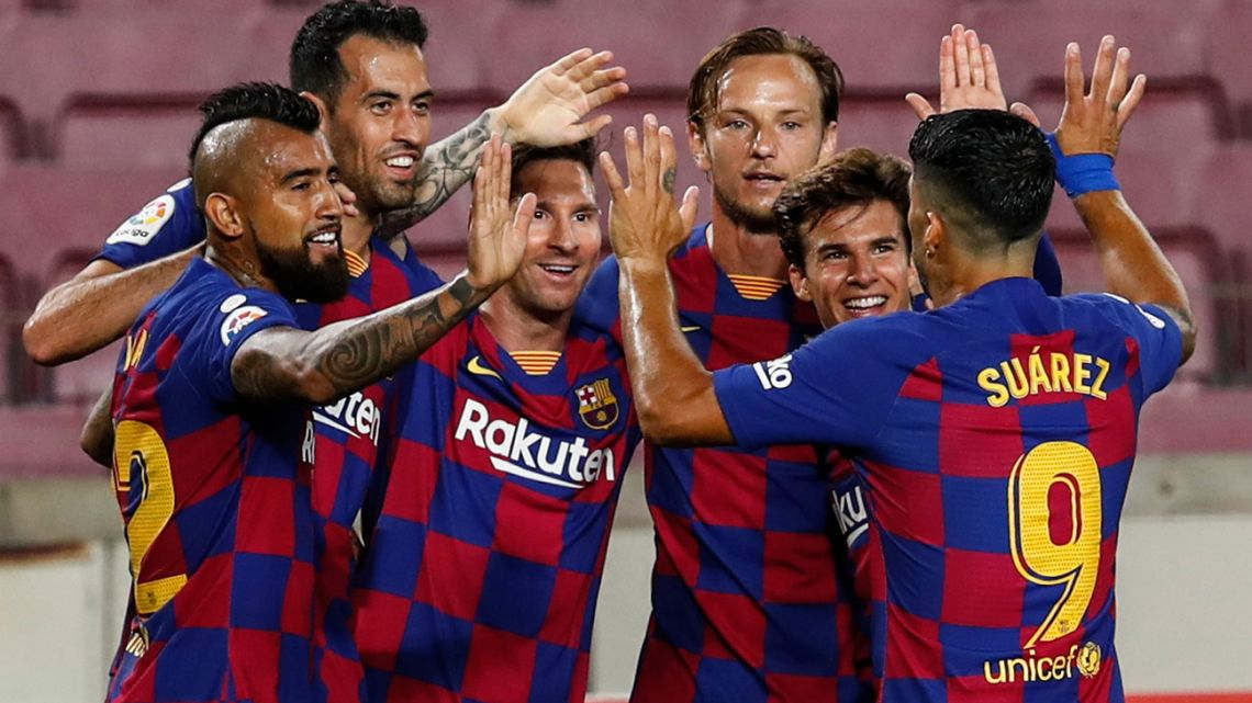 FC Barcelona players celebrate their opening goal during the La Liga match between FC Barcelona and Atlético Madrid at the Camp Nou stadium in Barcelona, Spain, Tuesday, June 30, 2020.