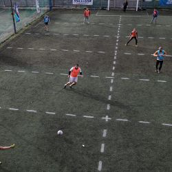 Amateur footballers play a new lockdown-acceptable form of the sport at the Play Futbol 5 local club in Pergamino. In order to continue playing amid government restrictions to curb the spread of the new coronavirus, the club divided its soccer field into 12 rectangles to mark limited areas for each player, keeping them from making physical contact.
