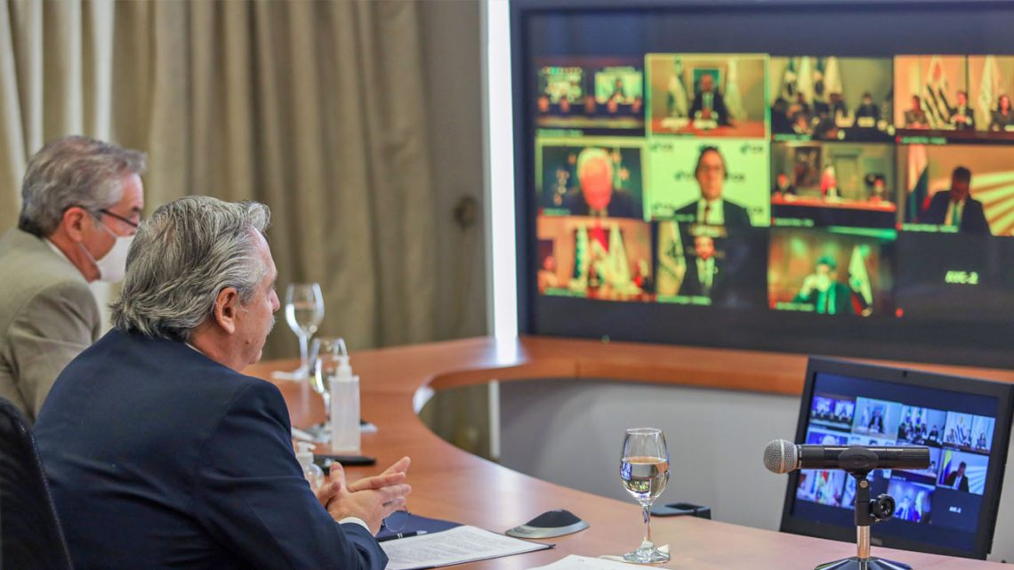 President Alberto Fernandez (right) and his Foreign Minister Felipe Sola take part in the first Mercosur Summit held via video conference due to the Covid-19 pandemic.