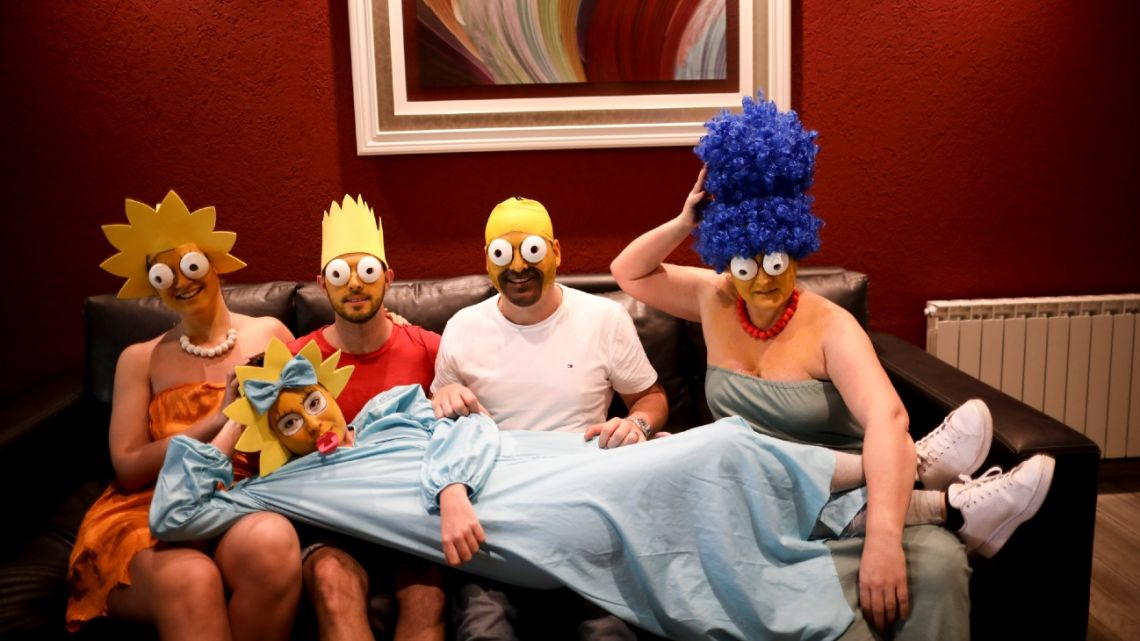 The Arévalo-Robledo family, dressed as The Simpsons, poses for a photo in their living room during a government-ordered lockdown to curb the spread of the new coronavirus in Buenos Aires, Argentina, Saturday, June 27, 2020.