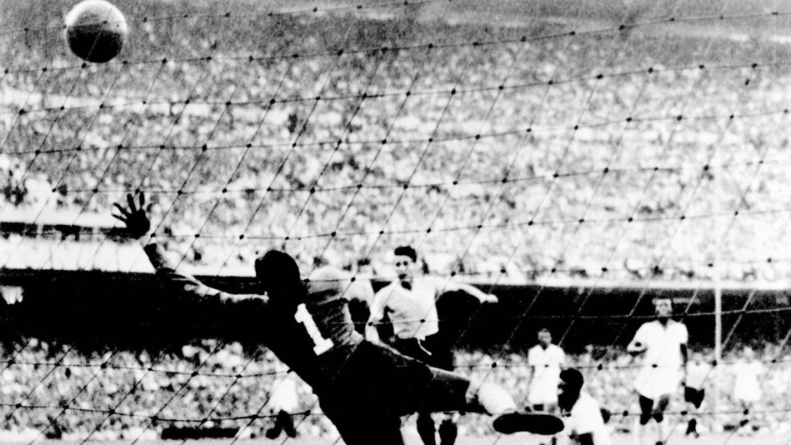 In this picture taken on July 16, 1950, Uruguayan Juan Schiaffino (centre) scores the team's first goal against Brazil, during the 1950 World Cup at Maracanã stadium in Rio de Janeiro, Brazil.