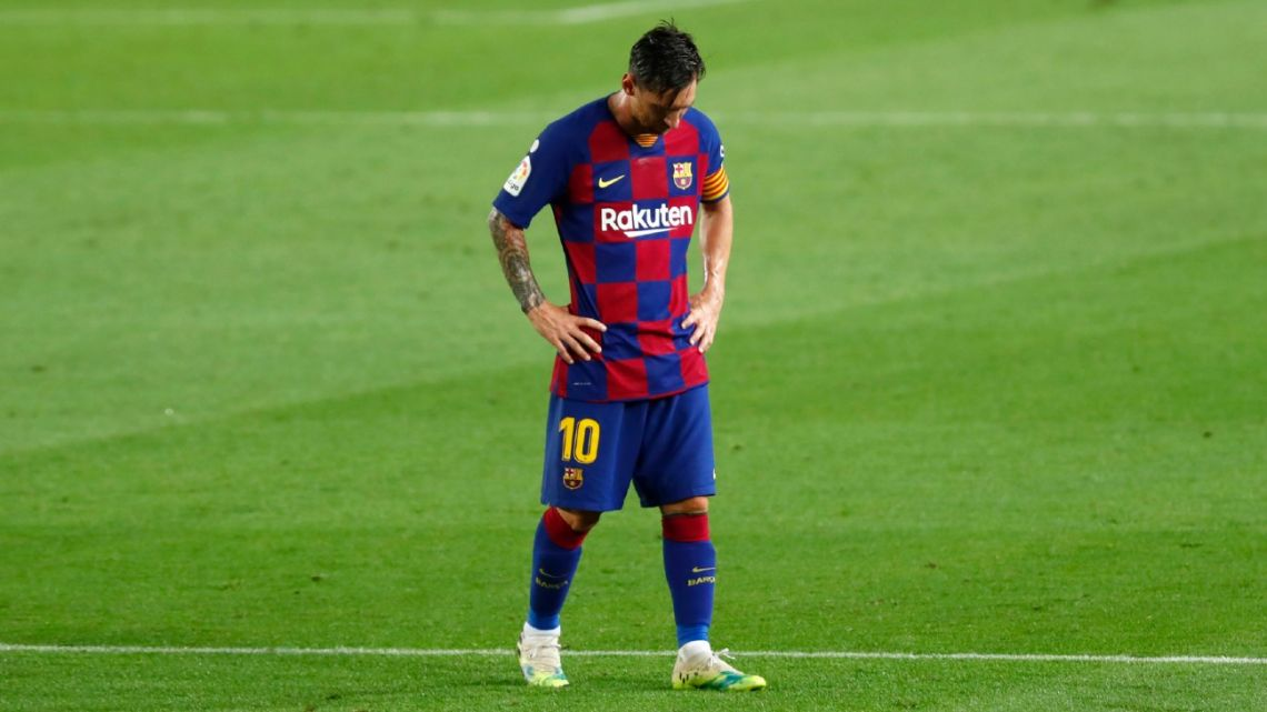 Barcelona's Lionel Messi dejected as walks after the end of a Spanish La Liga football match between Barcelona and Osasuna at the Camp Nou stadium in Barcelona, Spain, Thursday, July 16, 2020.