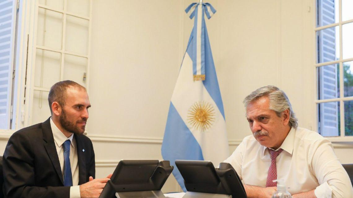 Economy Minister Martín Guzmán (left) and President Alberto Fernández.