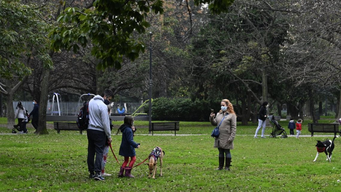 A family poses for a photo at Las Heras park after lockdown measures to fight the COVID-19 novel coronavirus pandemic were relaxed, in Buenos Aires, on July 21, 2020.
