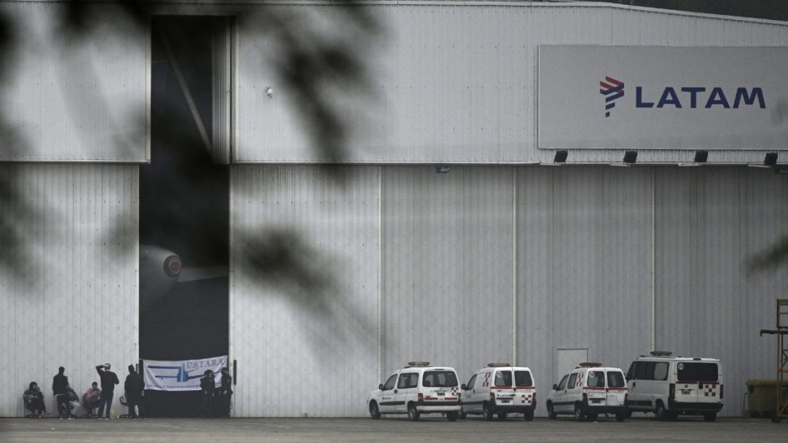 Workers of LATAM Argentina guard the company's hangar during a protest weeks after the company announced it was ceasing its domestic operations, at Jorge Newbery Airport in Buenos Aires.