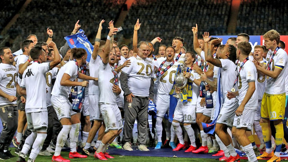 Leeds United manager Marcelo Bielsa celebrates with his players as they lift the English Championship trophy at Elland Road.