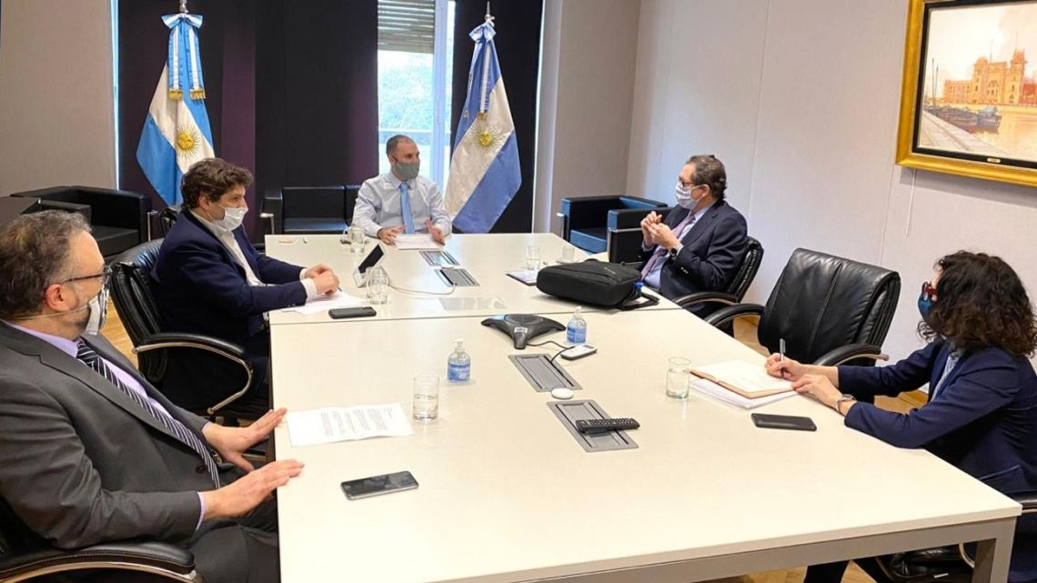 Economy Minister Martín Guzman leads a meeting with other officials at the Palacio de Hacienda on Monday.
