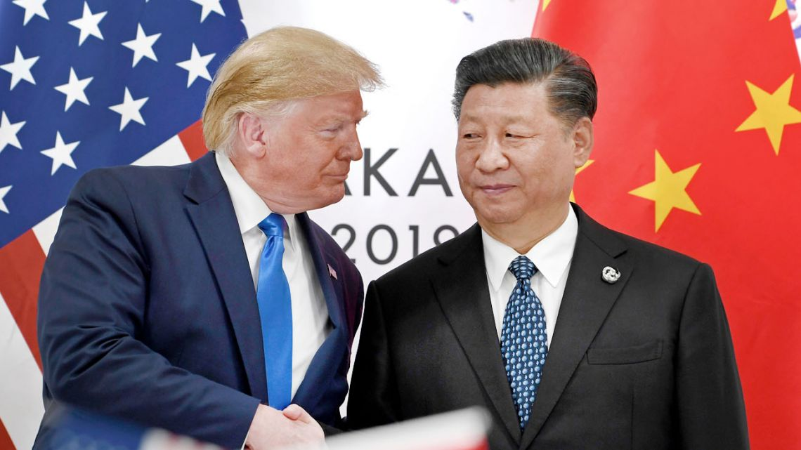 US President Donald Trump, left, shakes hands with Chinese President Xi Jinping during a meeting on the sidelines of the G20 summit in Osaka, western Japan, in June 2019.