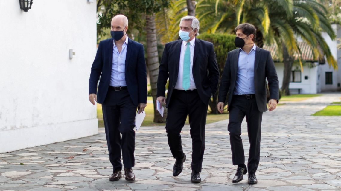 Handout picture released by Presidency shows President Alberto Fernández (centre), Buenos Aires Province Governor Axel Kicillof (right) and Buenos Aires City Mayor Horacio Rodríguez Larreta walking at the Olivos Presidential Residence.