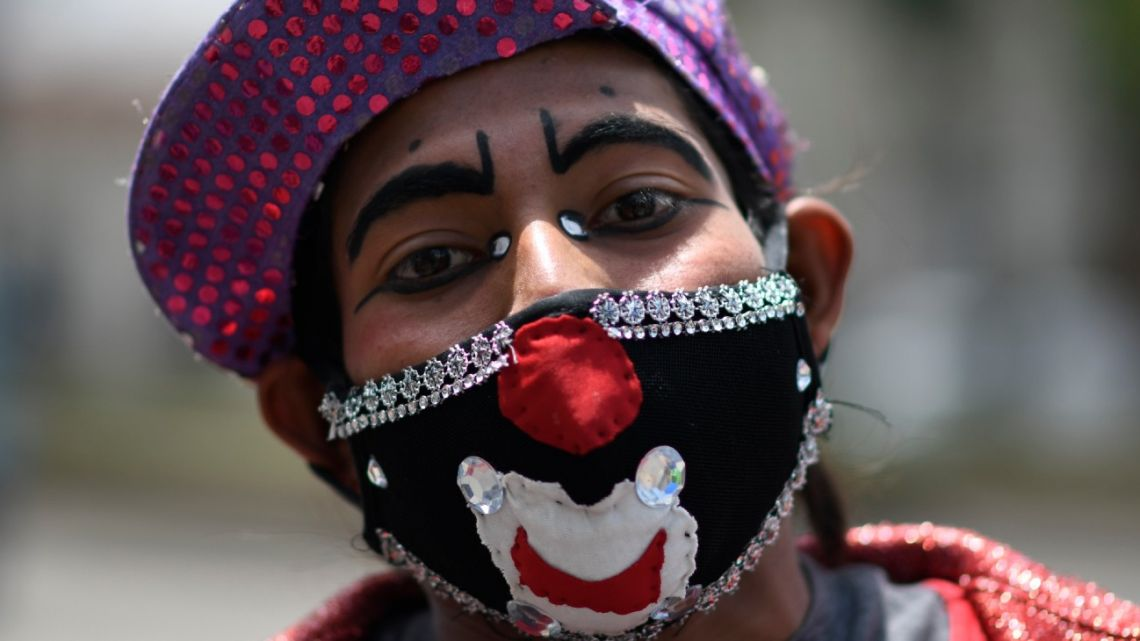 A clown wearing a face mask poses for a picture during a protest by artists from at least 30 circuses economically affected by the restrictions to fight the spread of the novel coronavirus COVID-19, for their situation, outside the Culture Palace in Guatemala City on August 3, 2020.