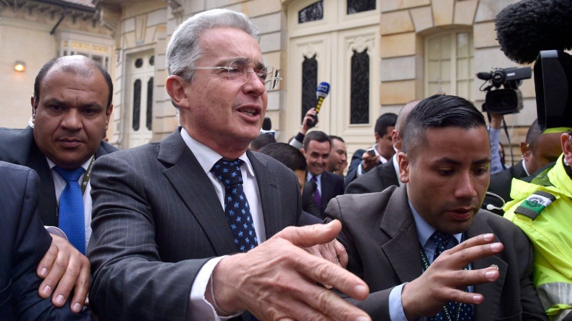 In this file photo taken on October 05, 2016 Colombian former president (2002-2010) and current Senator Álvaro Uribe gestures after a meeting with Colombian President Juan Manuel Santos at Narino presidential palace in Bogota. Uribe announced in his Twitter account on August 4, 2020 that an order has been issued for his arrest in a witness tampering investigation.