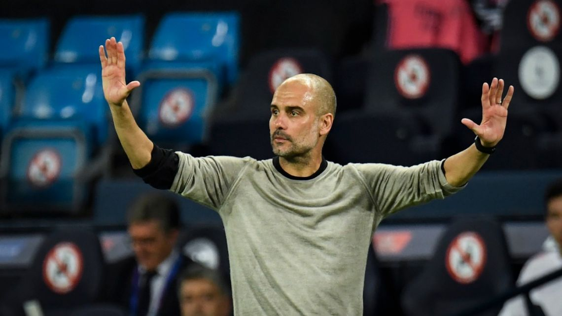 Manchester City's Spanish manager Pep Guardiola gestures during the UEFA Champions League round of 16 second leg football match between Manchester City and Real Madrid at the Etihad Stadium in Manchester, north west England on August 7, 2020.