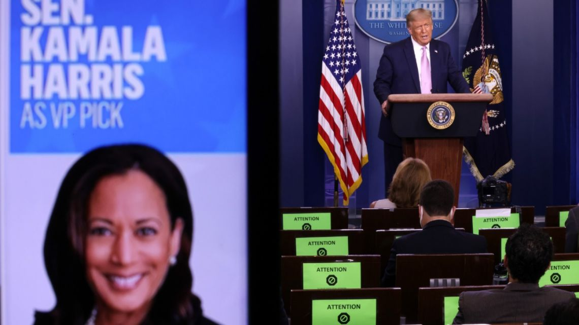U.S. President Donald Trump speaks as a picture of Sen. Kamala Harris (D-CA) is seen on a screen during a news conference in the James Brady Press Briefing Room of the White House August 11, 2020 in Washington, DC. ALEX WONG / GETTY IMAGES NORTH AMERICA / Getty Images via AFP