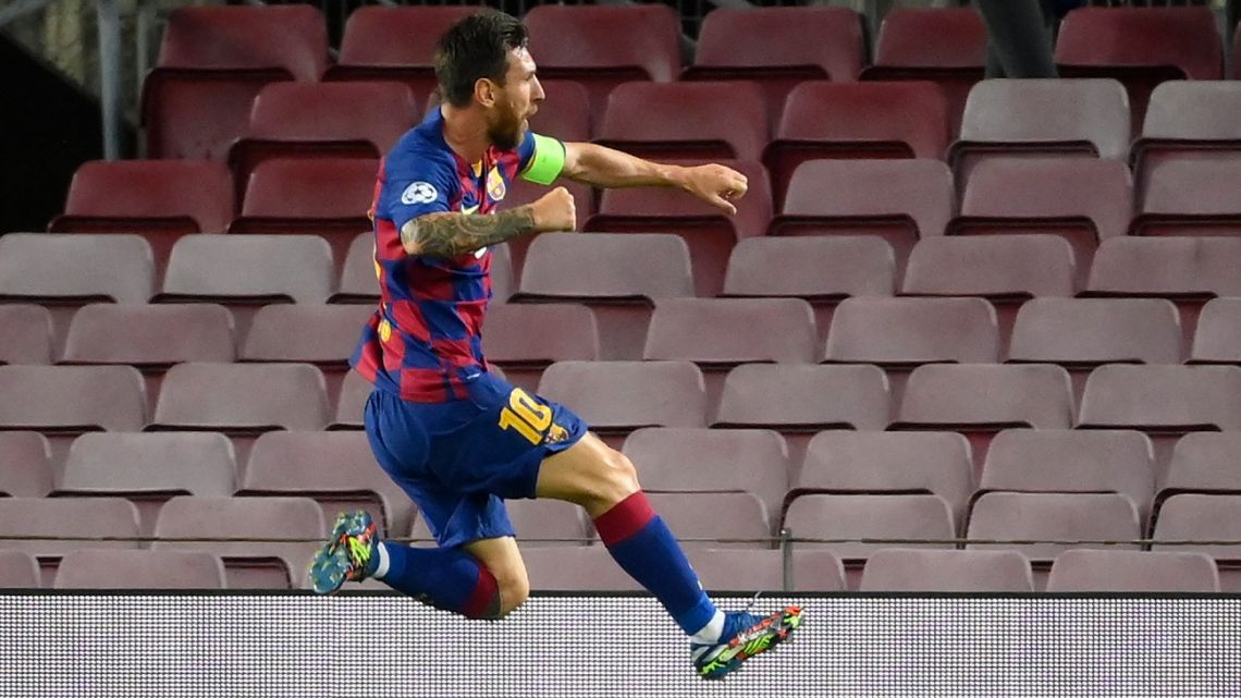 Barcelona forward Lionel Messi celebrates after scoring a goal during the UEFA Champions League round of 16 second leg football match between FC Barcelona and Napoli at the Camp Nou stadium in Barcelona on August 8, 2020.