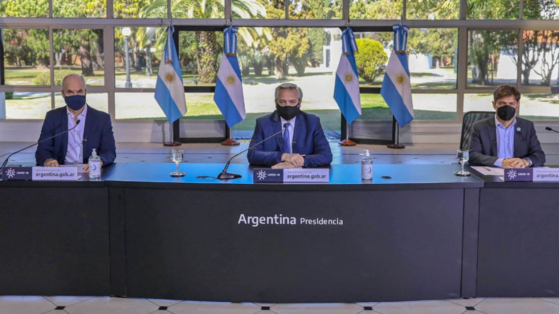 President Alberto Fernández, flanked by City Mayor Horacio Rodríguez Larreta, and Buenos Aires Province Governor Axel Kicillof, offers a press conference to announce new measures regarding the lockdownat the Olivos Presidential Residence.