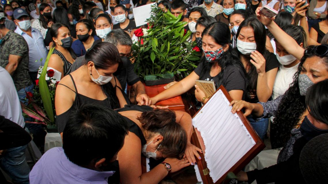 Friends and relatives mourn next to the coffin of one of the eight youngsters murdered in a rural area of Samaniego, Nariño department, Colombia, on August 17, 2020.