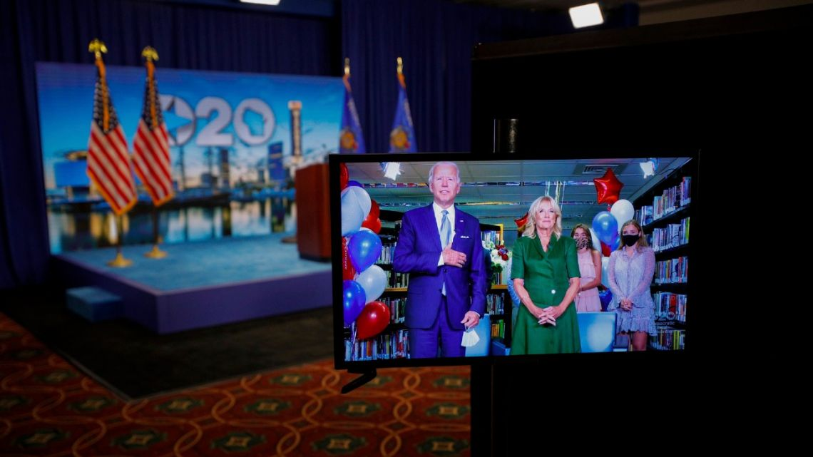 Democratic presidential candidate former Joe Biden is seen in a video feed from Delaware with his wife Jill Biden, and his grandchildren at his side, after winning the votes to become the Democratic Party's 2020 nominee for president, during the second night of the virtual 2020 Democratic National Convention in Milwaukee.