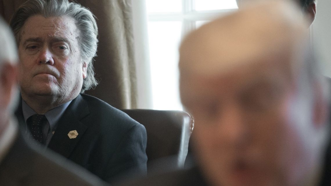 This March 13, 2017 file photo shows former senior White House adviser Steve Bannon listening as US President Donald Trump speaks to the press before meeting with his Cabinet in the Cabinet Room of the White House in Washington DC.