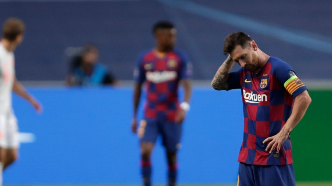 Barcelona's Lionel Messi holds his head during the Champions League quarterfinal match between FC Barcelona and Bayern Munich at the Luz stadium in Lisbon, Portugal, Friday, Aug. 14, 2020.