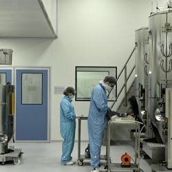 Scientists work at the mAbxience biosimilar monoclonal antibody laboratory plant in Garin, Buenos Aires Province.