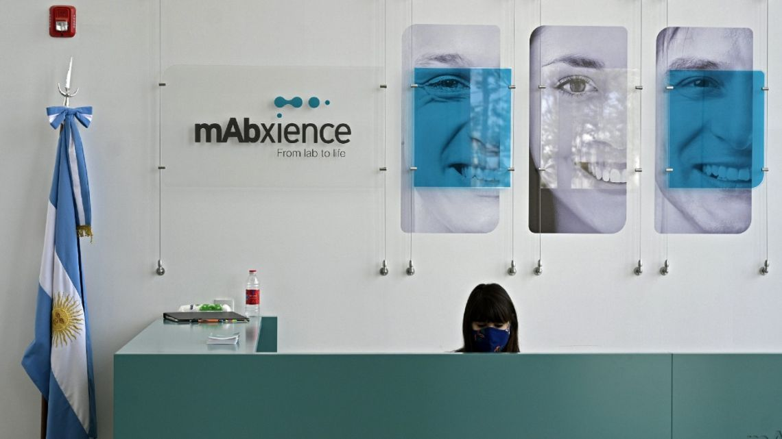 View of the an Argentine flag by the reception desk of the mAbxience biosimilar monoclonal antibody laboratory plant where an experimental coronavirus vaccine will be produced for Latin America in Garin, Buenos Aires Province.