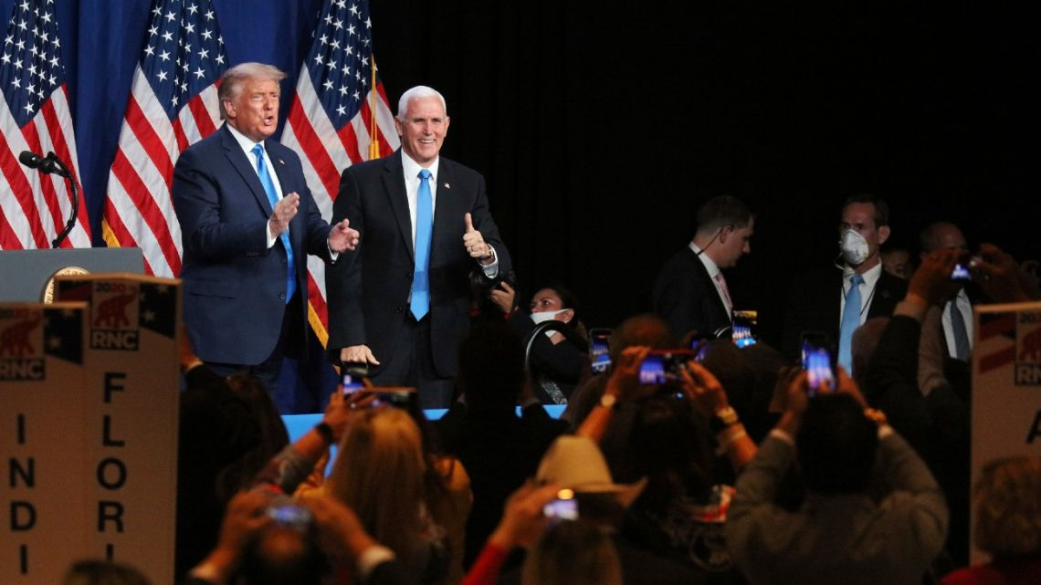 US President Donald Trump and US Vice-President Mike Pence give a thumbs up after speaking during the first day of the Republican National Convention Monday, August 24, 2020, in Charlotte, North Carolina.