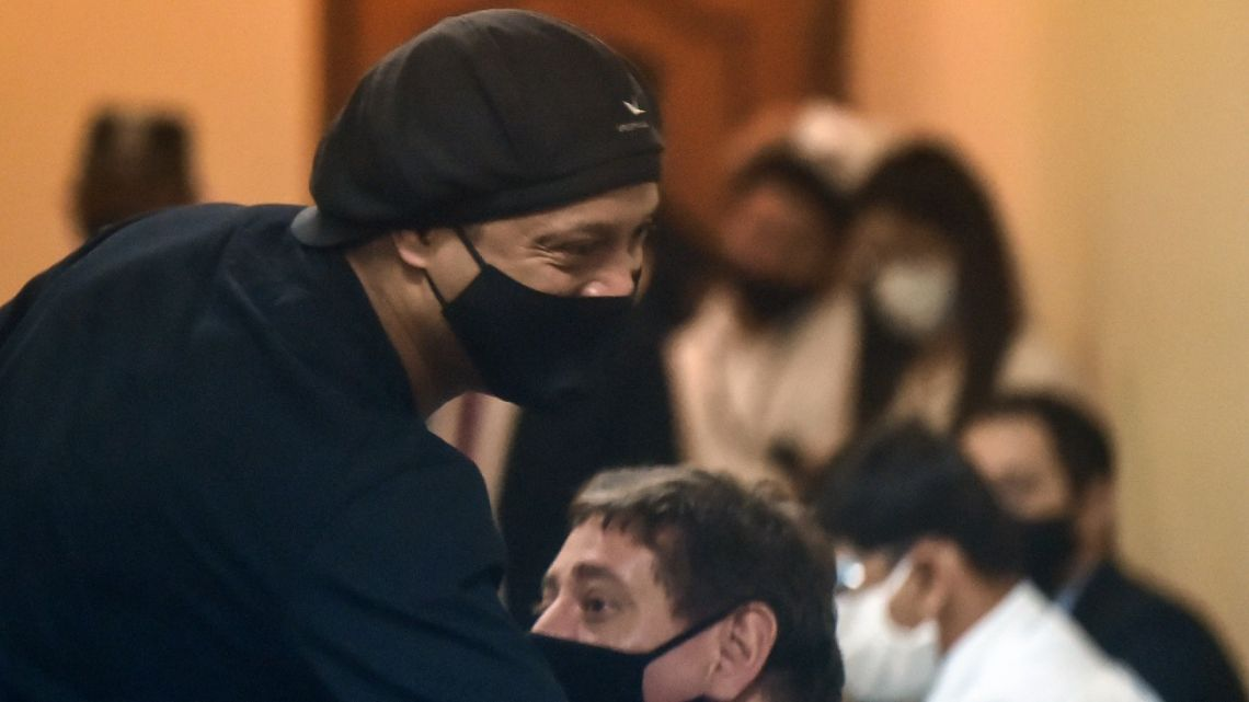 Brazilian retired football player Ronaldinho arrives for his hearing at the Asunción's Justice Palace, in Asunción, on August 24, 2020. After six months under arrest in Paraguay, former Brazil football star Ronaldinho was set for a hearing on Monday on charges of travelling with false documents, according to judicial sources.