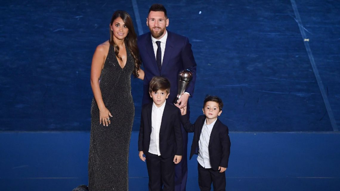 In this file photo taken on September 23, 2019, Best FIFA Men's Player of 2019, Argentina and Barcelona forward Lionel Messi poses with his wife Antonella Roccuzzo Messi and their children at the end of The Best FIFA Football Awards ceremony in Milan.