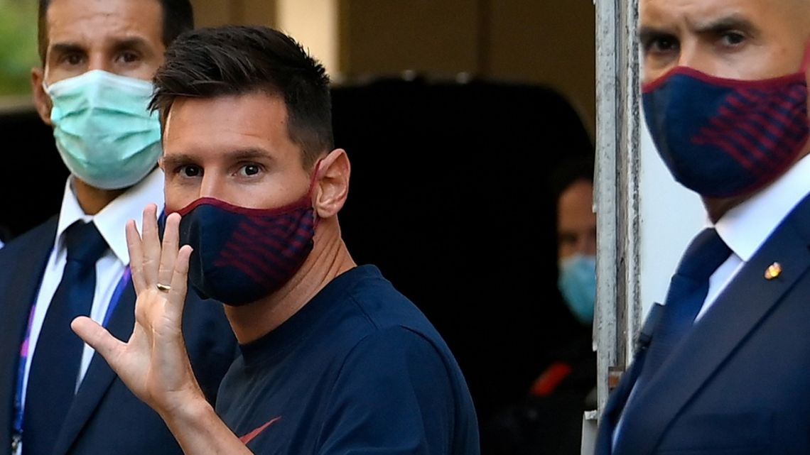 In this file photo taken on August 14, 2020, Barcelona's Argentine forward Lionel Messi waves as he leaves the hotel to the stadium in Lisbon ahead of the Champions League quarter-final football match between FC Barcelona and Bayern Munich.
