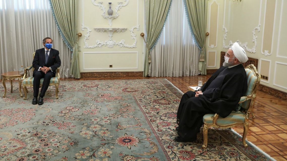 A handout picture provided by the Iranian presidency on August 26, 2020 shows President Hassan Rouhani (R) meeting with Director General of the International Atomic Energy Agency (IAEA) Rafael Mariano in Tehran.